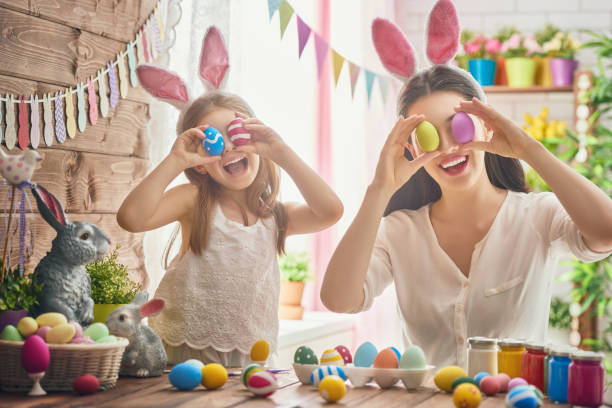 family preparing for easter - easter stock pictures, royalty-free photos & images