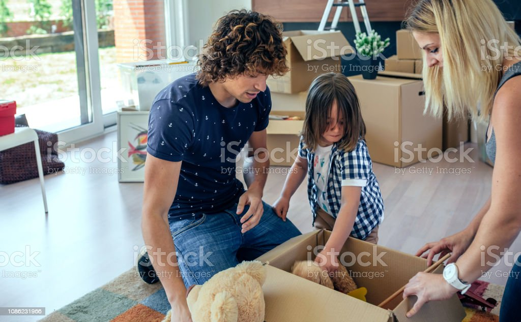 Family preparing moving toy box stock photo