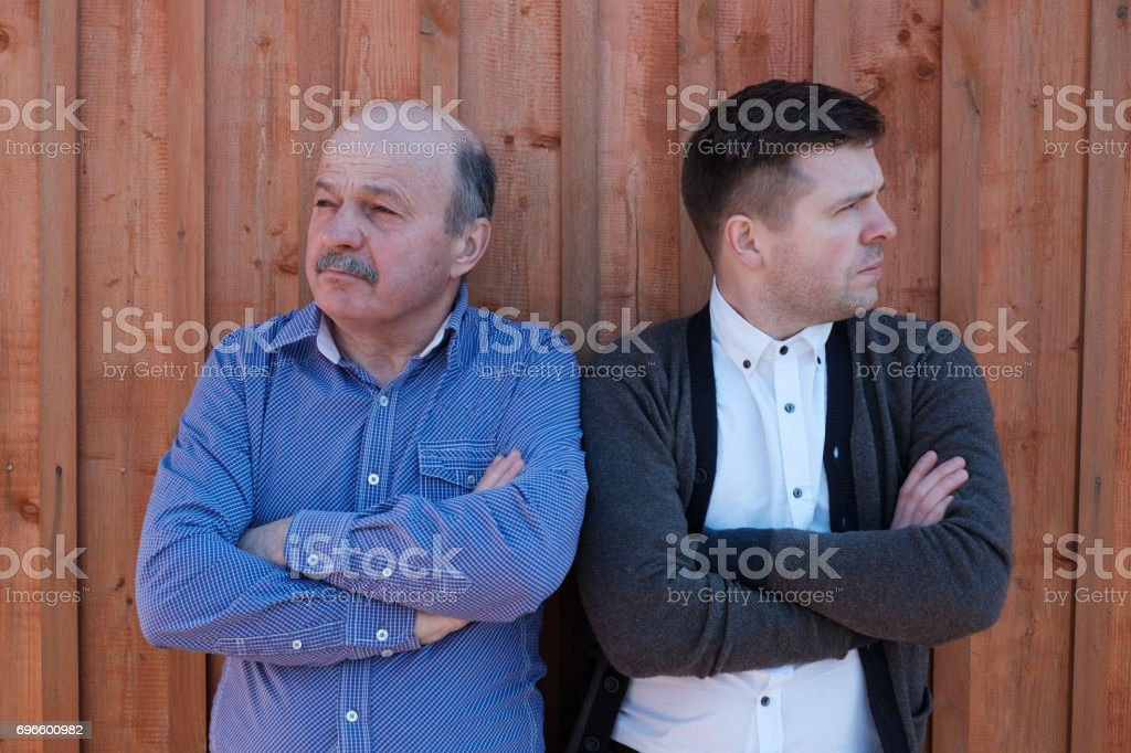 Family problems between son and father stock photo
