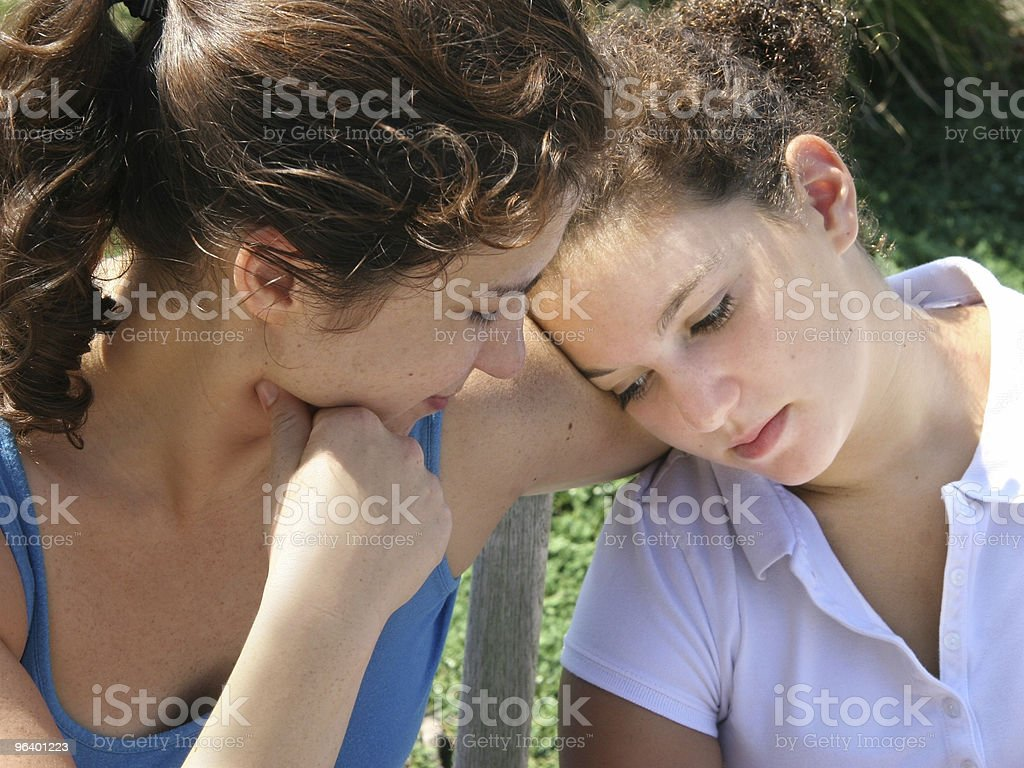 Family problems with older woman comforting younger woman royalty-free stock photo
