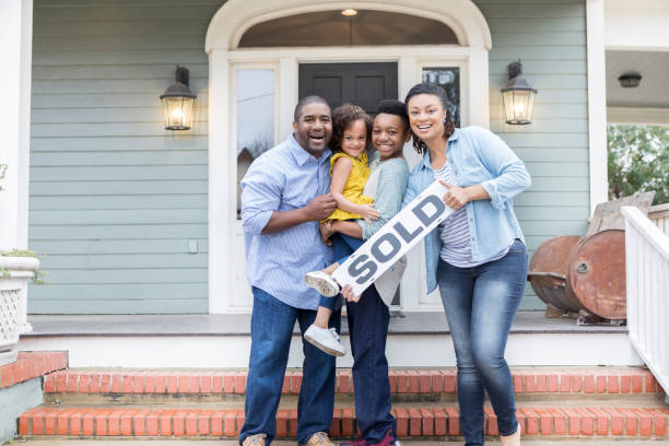 Family proud of their new home stock photo