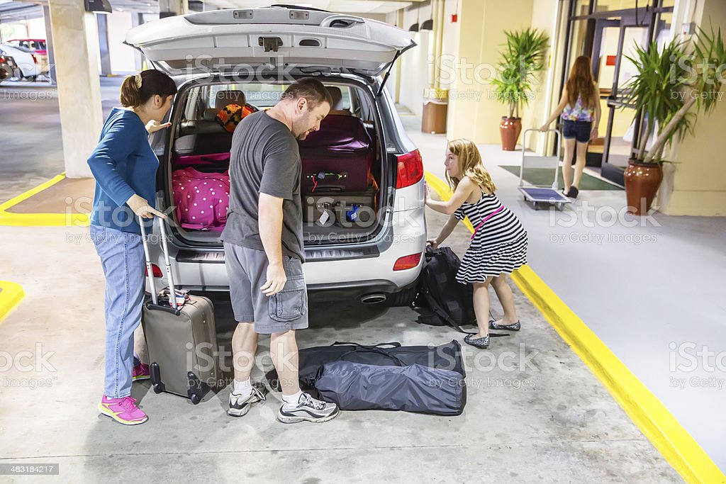 Family puts their luggage in the car royalty-free stock photo