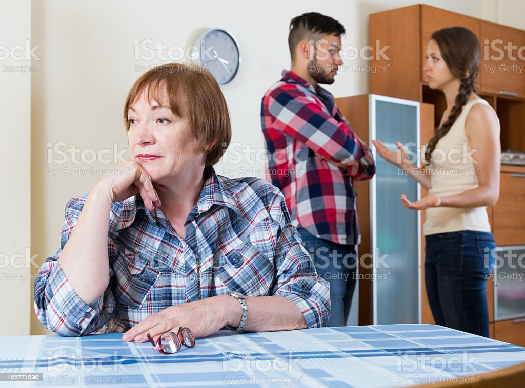 family quarrels with the husbands mother stock photo