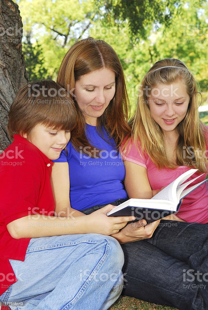 Family reading a book royalty-free stock photo