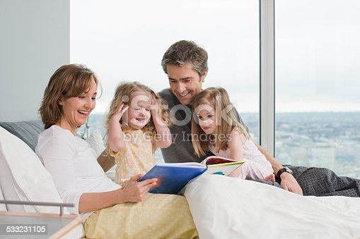 istock family reading a book 533231105