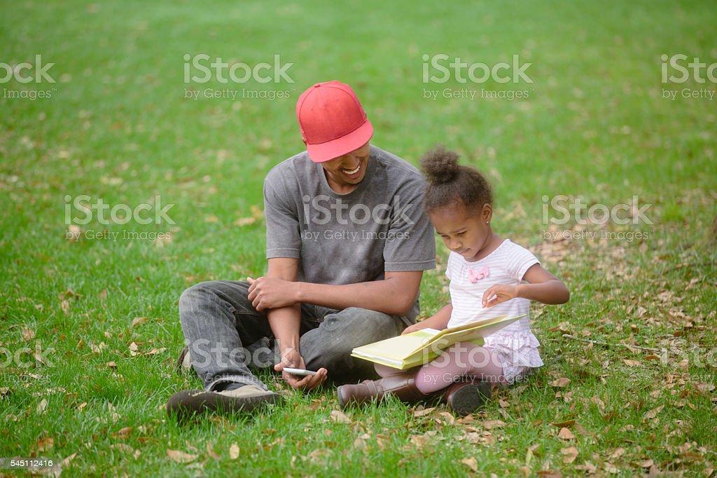Family Reading at Park stock photo
