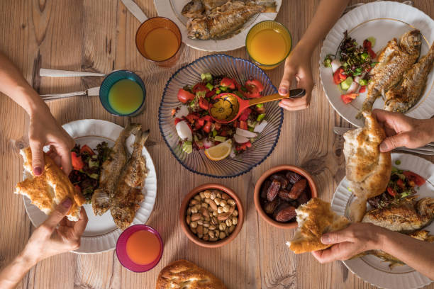 family ready for i̇ftar meal in ramadan - ramadan stock photos and pictures