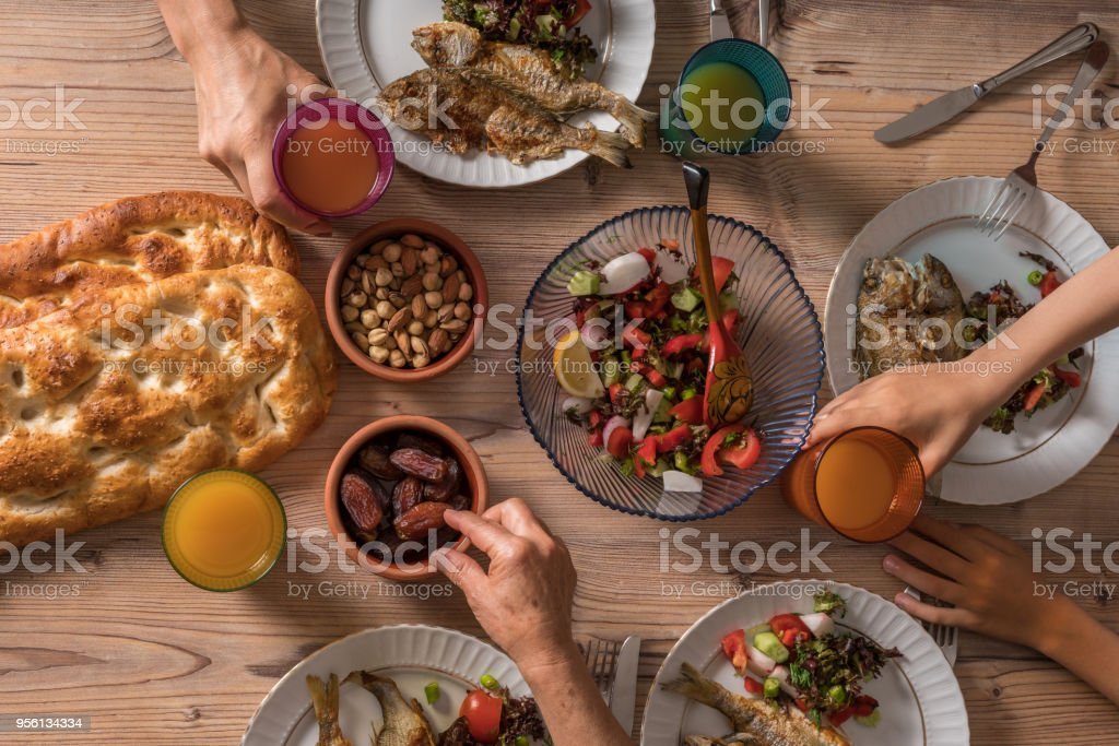 Family ready for İftar meal in Ramadan stock photo