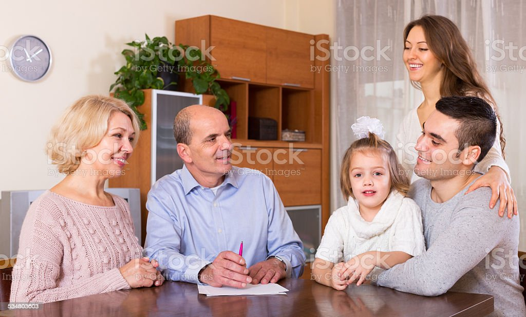 family ready to sign banking documents stock photo