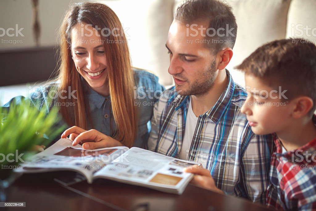 Family reeding magazine stock photo