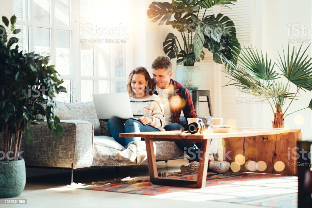 Family relationship. Happy couple at home on the couch royalty-free stock photo