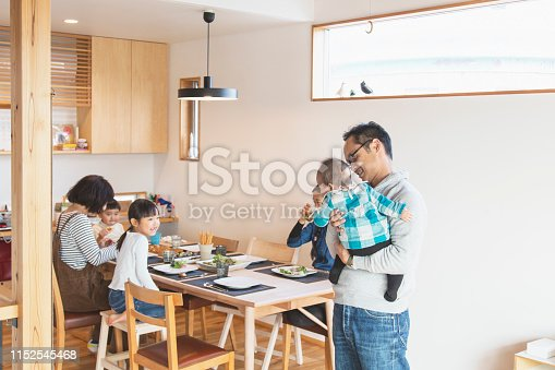 1152545468 istock photo Family relaxed at home 1152545468