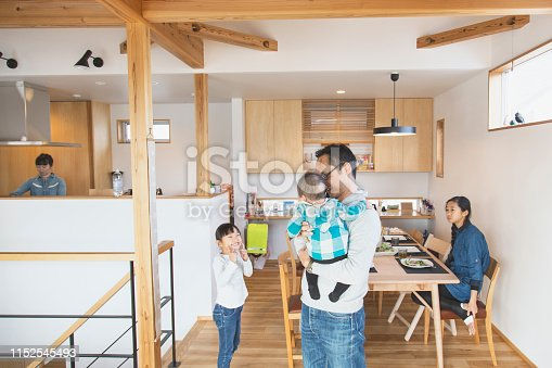 1152545468 istock photo Family relaxed at home 1152545493