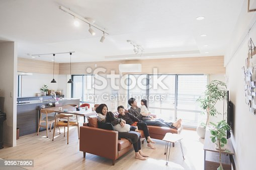 1152545468 istock photo Family relaxed on sofa at home 939578950