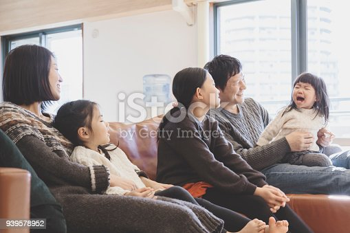 1152545468 istock photo Family relaxed on sofa at home 939578952