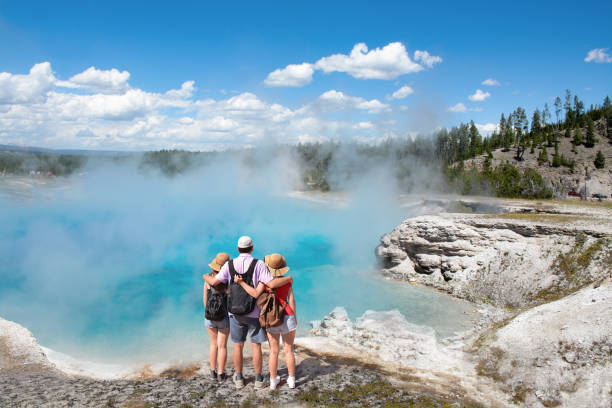 family relaxing and enjoying beautiful view on vacation hiking trip. - national park stock photos and pictures