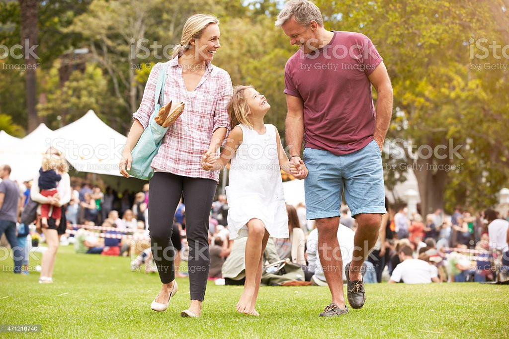 Family Relaxing At Outdoor Summer Event stock photo
