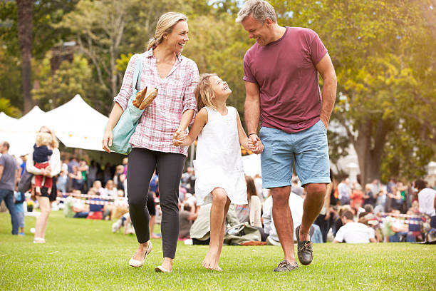 Family Relaxing At Outdoor Summer Event Family Relaxing At Outdoor Summer Event farmer's market stock pictures, royalty-free photos & images