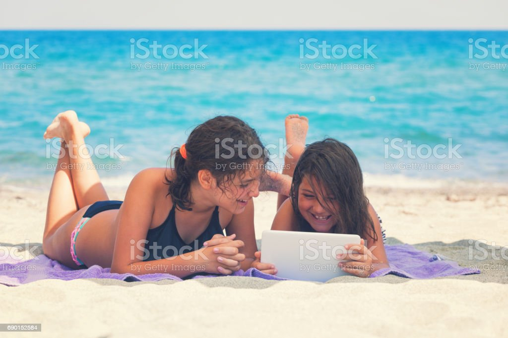 family relaxing at the beach stock photo more pictures of 12 13