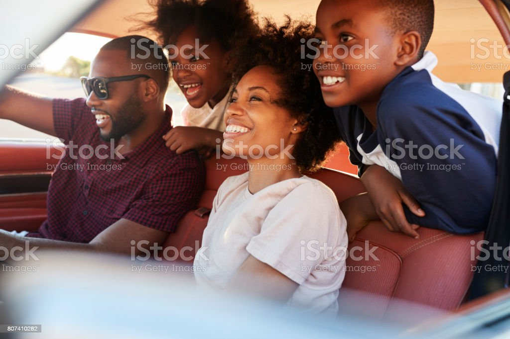 Family Relaxing In Car During Road Trip stock photo