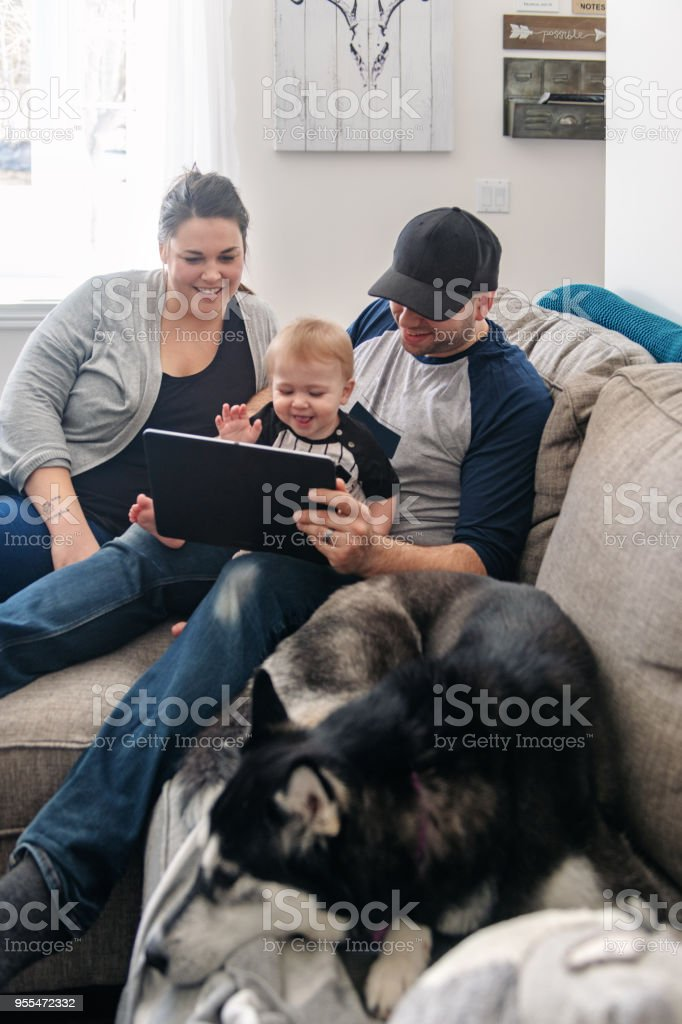 Family relaxing in living room stock photo