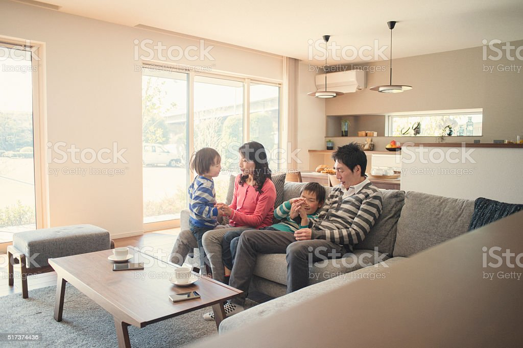 Family relaxing in the living room stock photo