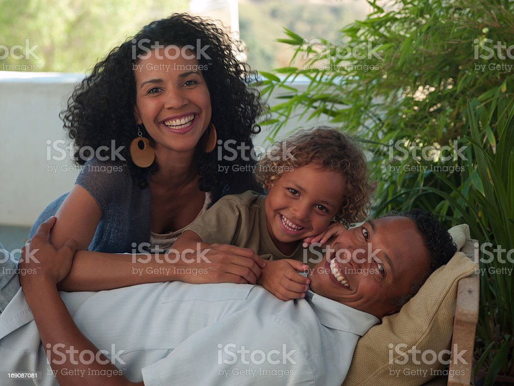 Family relaxing on patio royalty-free stock photo