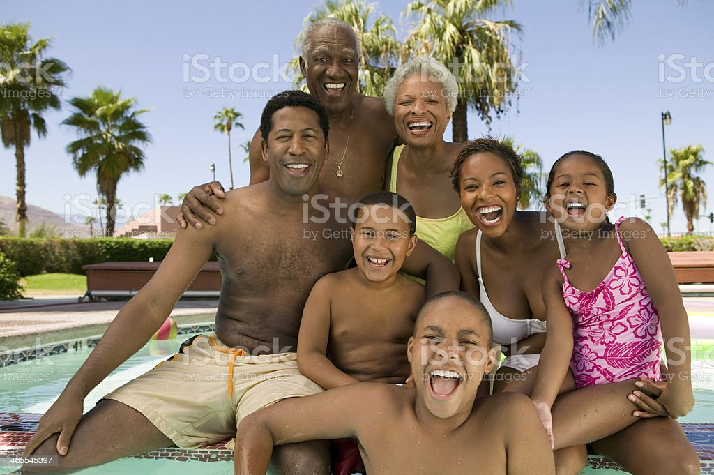 Family Relaxing Poolside royalty-free stock photo