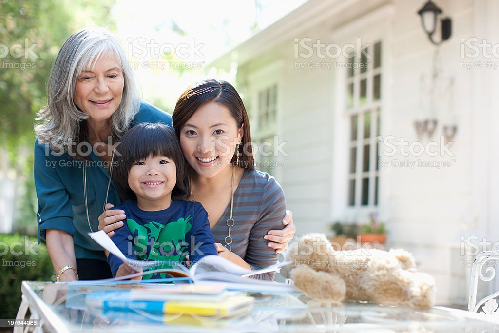 Family relaxing together outdoors stock photo