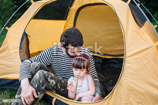 istock Family rest in tent, dad and daughter tourists 580135322