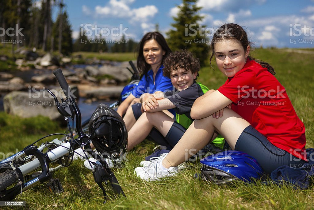 Family resting after biking royalty-free stock photo