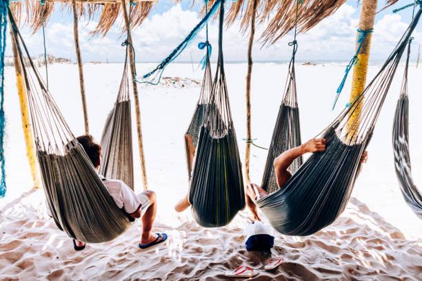 Family resting on hammock at lenois maranhenses picture id995013538?b=1&k=6&m=995013538&s=612x612&w=0&h=2ocy5fzrtk7ipakquye1nnh5rutvh3lror k7ybo5di=