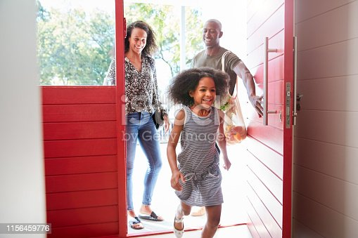 670900812 istock photo Family Returning Home From Shopping Trip Using Plastic Free Grocery Bags Opening Front Door 1156459776