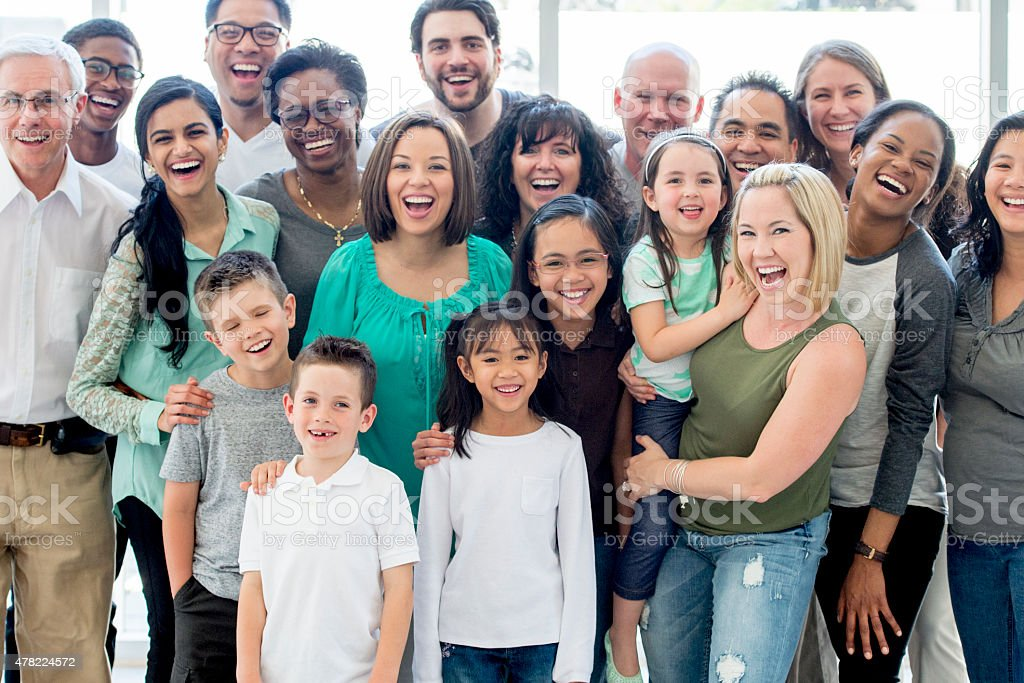 Family Reunion A multi-ethnic family group standing together happily while smiling and looking at the camera. 2015 Stock Photo