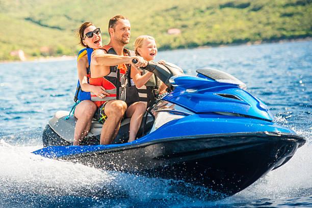 Famille prendre une Moto des mers - Photo