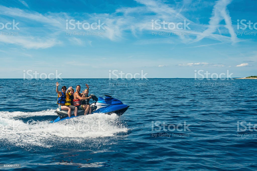 Family Riding A Jet Boat stock photo