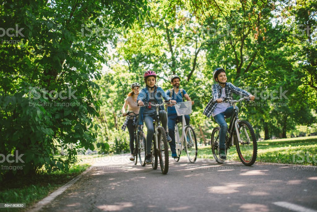 Family riding bicycle stock photo