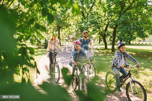 istock Family riding bicycle 694181048
