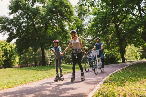 Family riding bicycle stock photo