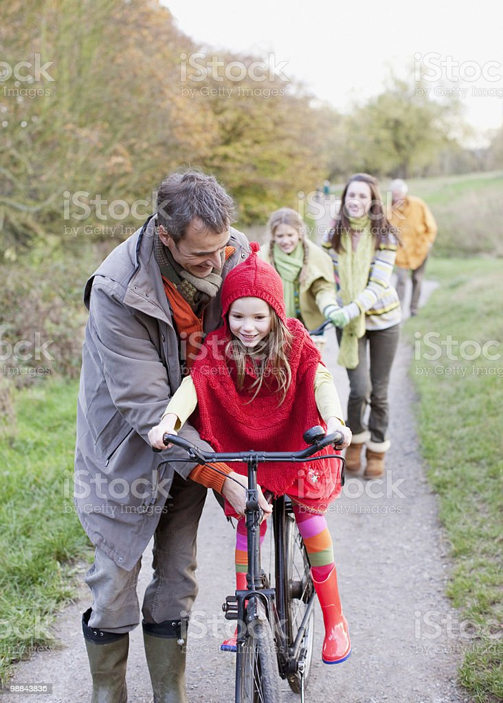 Family riding bicycles in park royalty-free stock photo
