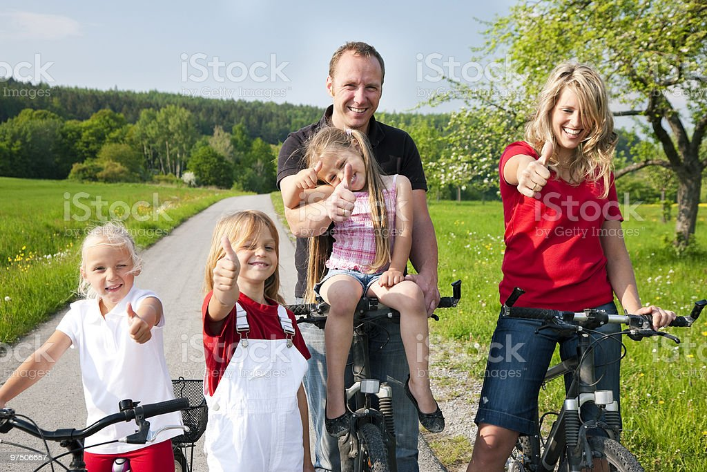 Family riding bicycles in spring royalty-free stock photo