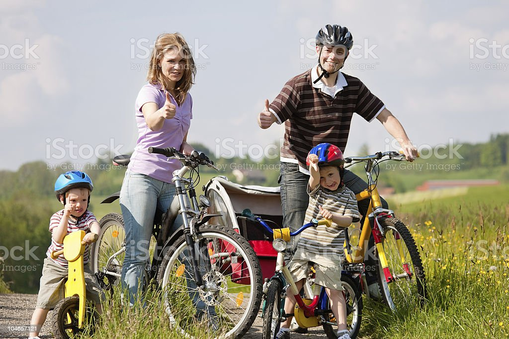 Family riding bicycles in summer royalty-free stock photo