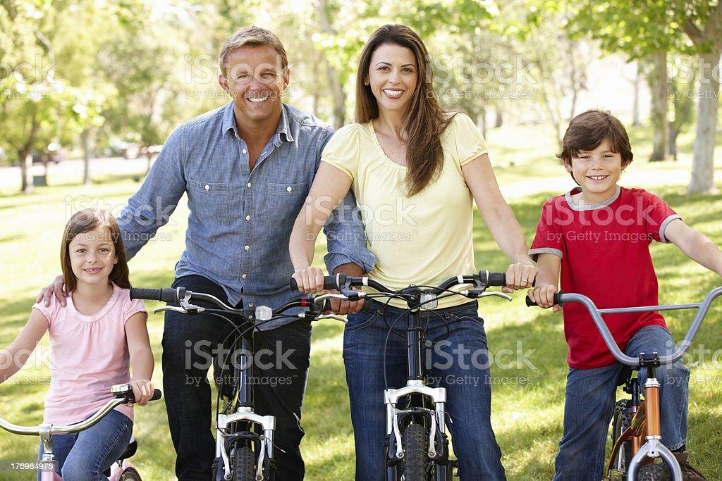 Family riding bikes in park royalty-free stock photo