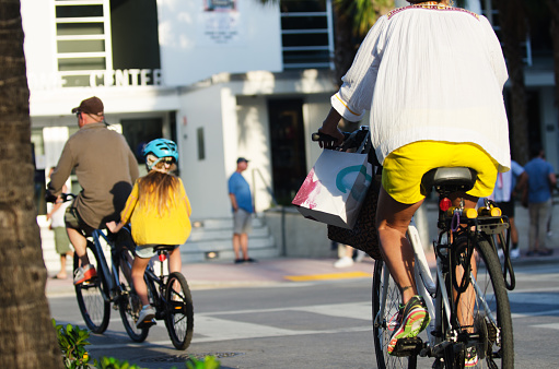 Family Riding Bikes Ocean Drive In South Beach Miami Stock Photo - Download Image Now