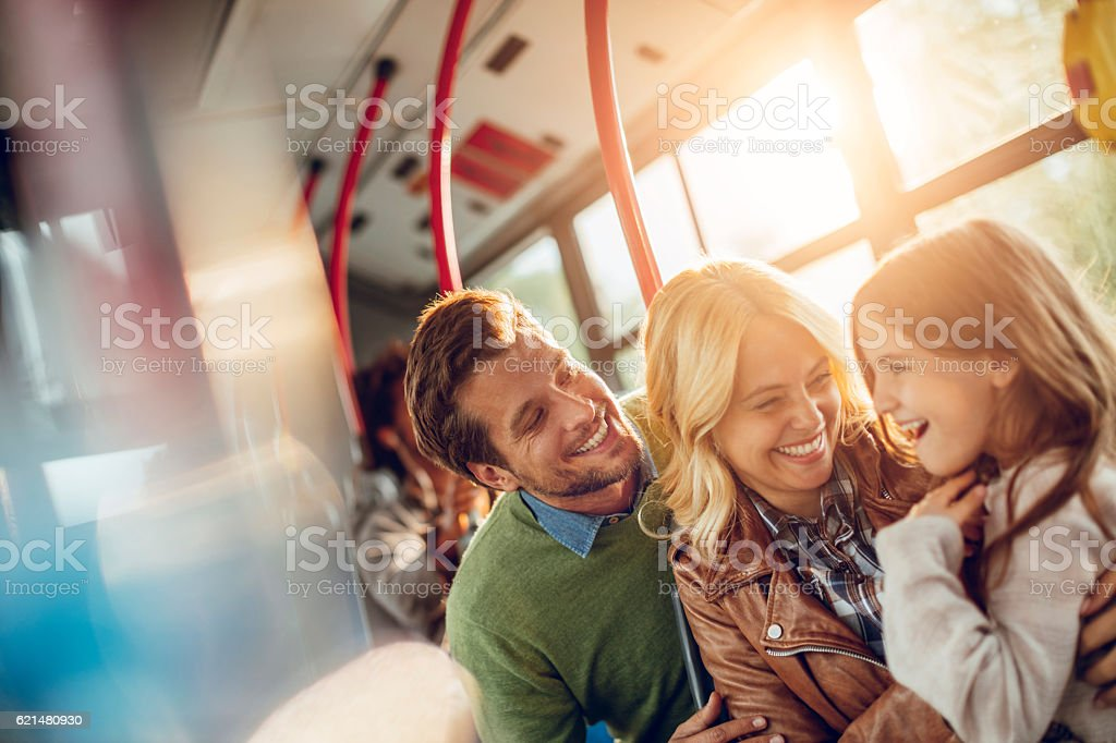 Family riding in a bus stock photo