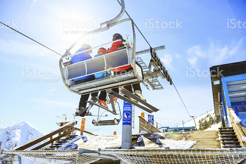 family riding in the ski lift stock photo