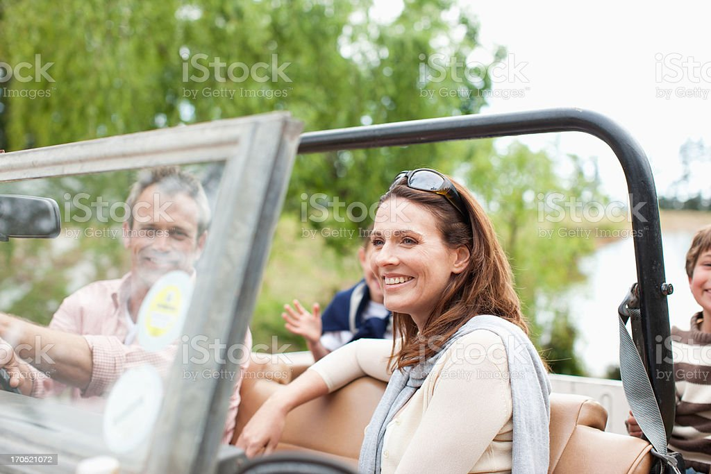 Family riding in vehicle stock photo