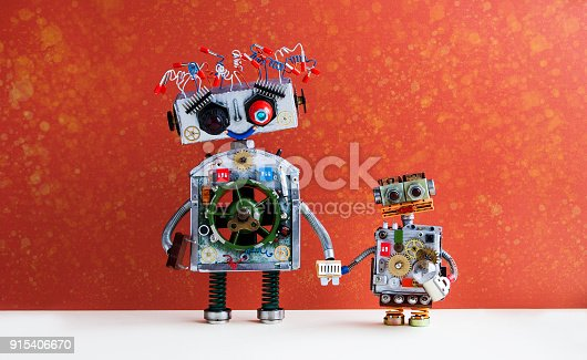 istock Family robots. Big robot mom holds the hand of a small child robot. Creative design futuristic cyborg toys on red wall background 915406670