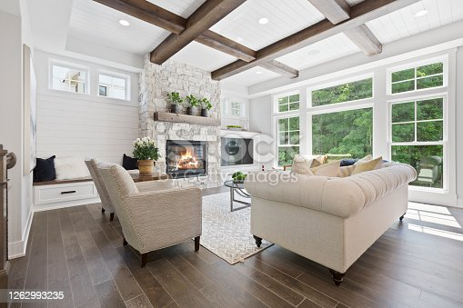 Hardwood flooring and wood beams on the coffered ceiling