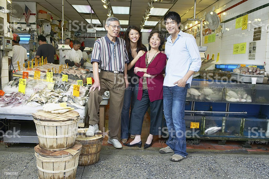 Family run fishmongers, portrait royalty-free stock photo